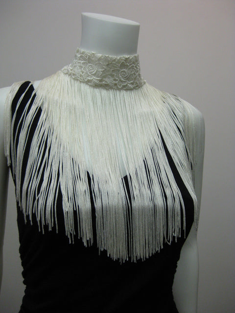 "Lace choker with 11"" rayon fringe and snap closure."