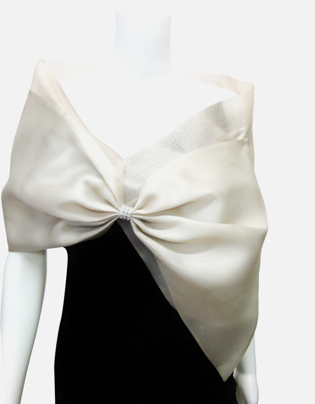 Bridal Satin faced organza wrap with silk organza collar and rhinestone center; snap closure.