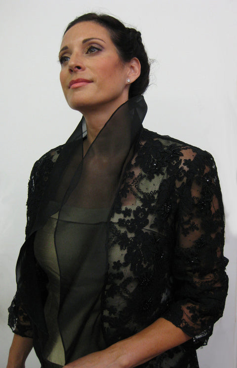 This beautiful, corded lace jacket has a flowing organza collar and rouched sleeves.  It is available in black, white or cream and in several sizes.  A timeless piece that may be worn for evening or paired with jeans for a modern look.