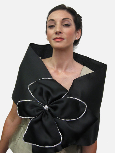 "Satin faced organza wrap with large bow and rhinestone trim.  It measures 51"" x 14"" and has a snap closure.  Dramatic and elegant."