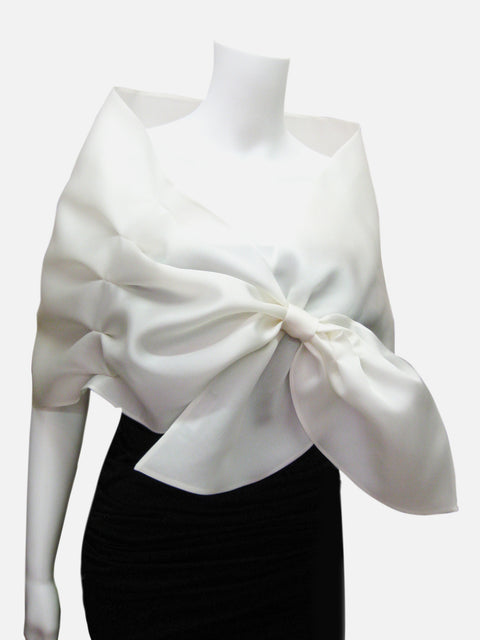 White Satin faced organza wrap with pleated detail and loop closure.