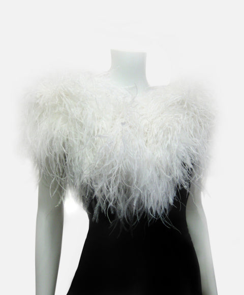 White ostrich feathers on silk organza backing and tie closure.