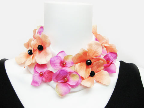 Artificial flowers choker with center bead on satin faced organza band; snap closure.