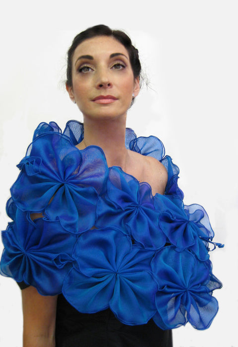 This is a blue metallic silk organza flower wrap made of 64 individual pieces that are then attached to form this beautiful evening wrap.