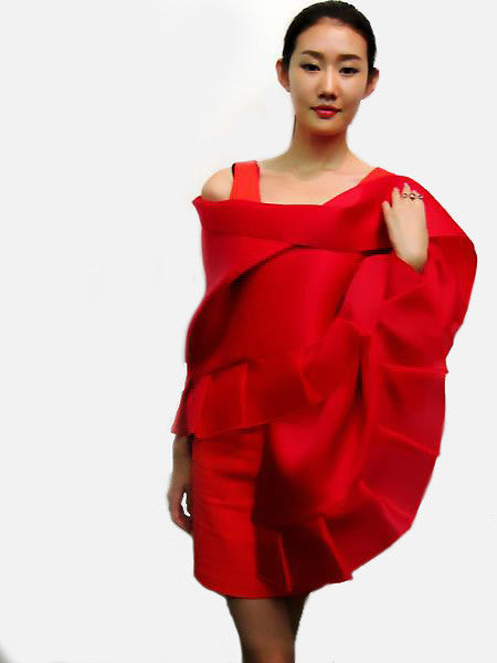 "This red, 100% silk evening shawl has a ruffled bottom and measures 82"" x 18"".  It is luxurious, bold and dramatic.  Wear it for your special occasion."