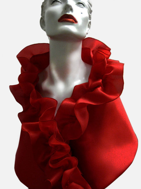 This is a red satin faced organza evening wrap with a rouched collar and a snap closure.