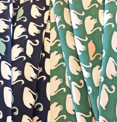 Swans on soft stretch knit fabric