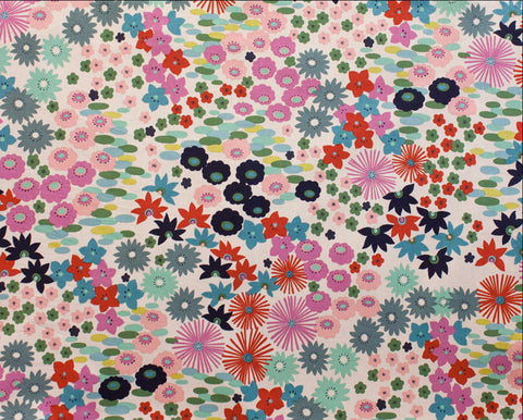Pretty pink and blue flower blossoms on white cotton from Alexander Henry Fabrics