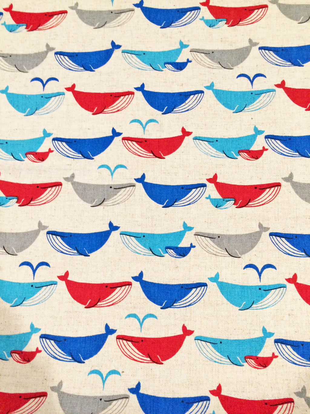 Mulitcolored whales on gray canvas from Kokka Fabrics - view 1
