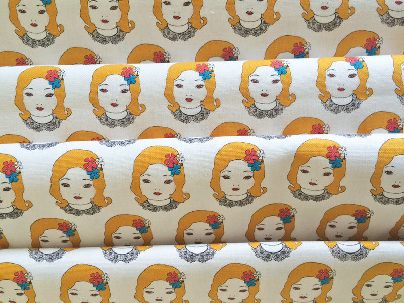 Unique Japanese canvas fabric of girl faces from Kokka - view 3