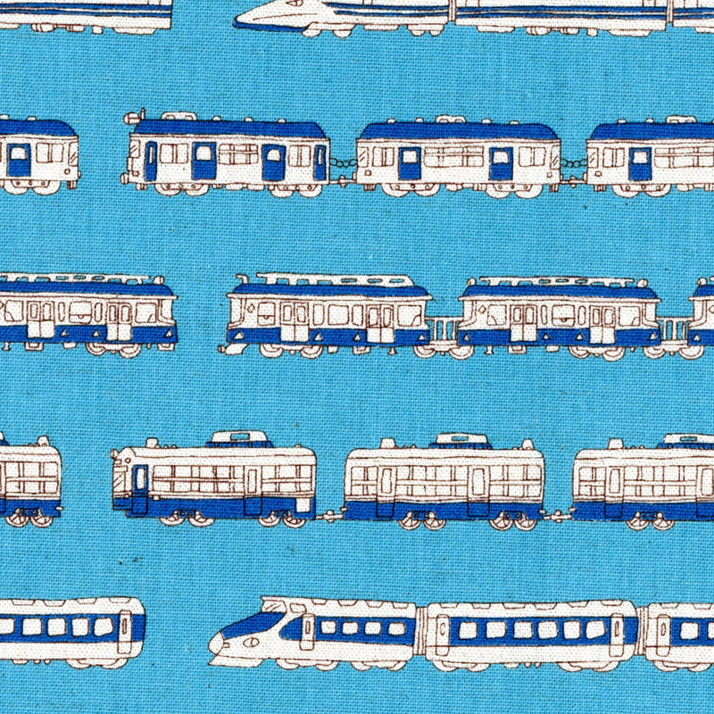 White trains on blue canvas from Kokka Fabrics - view 1