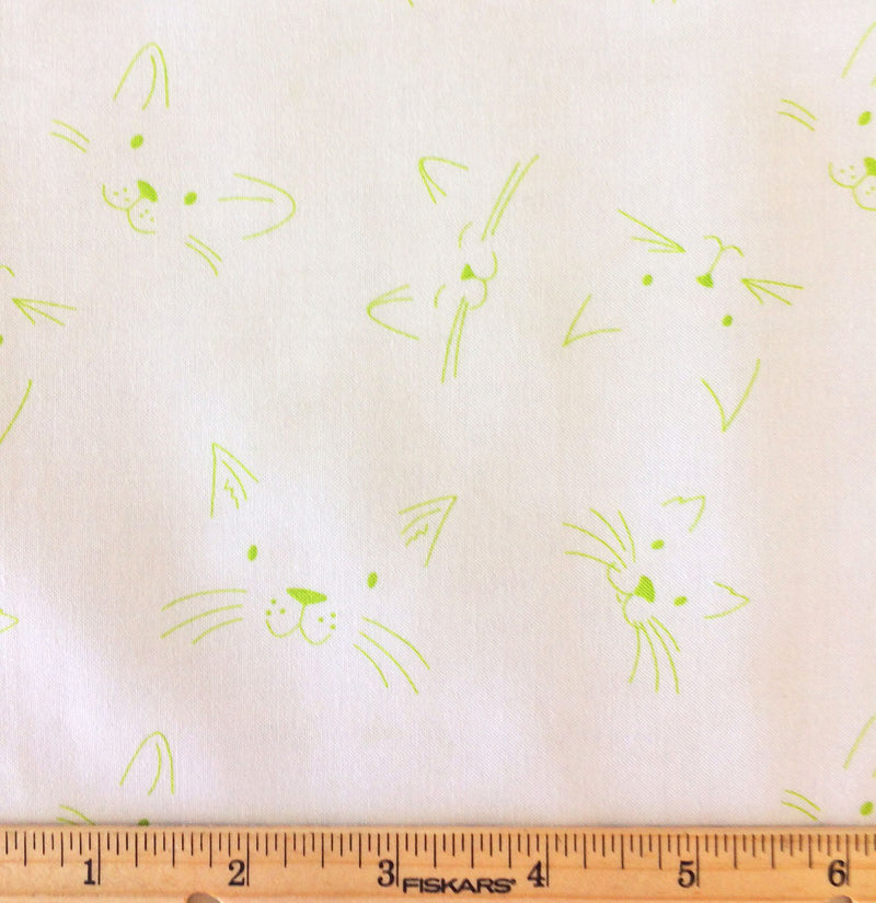 Green cat faces on white cotton from Ella Blue Fabrics - view 3