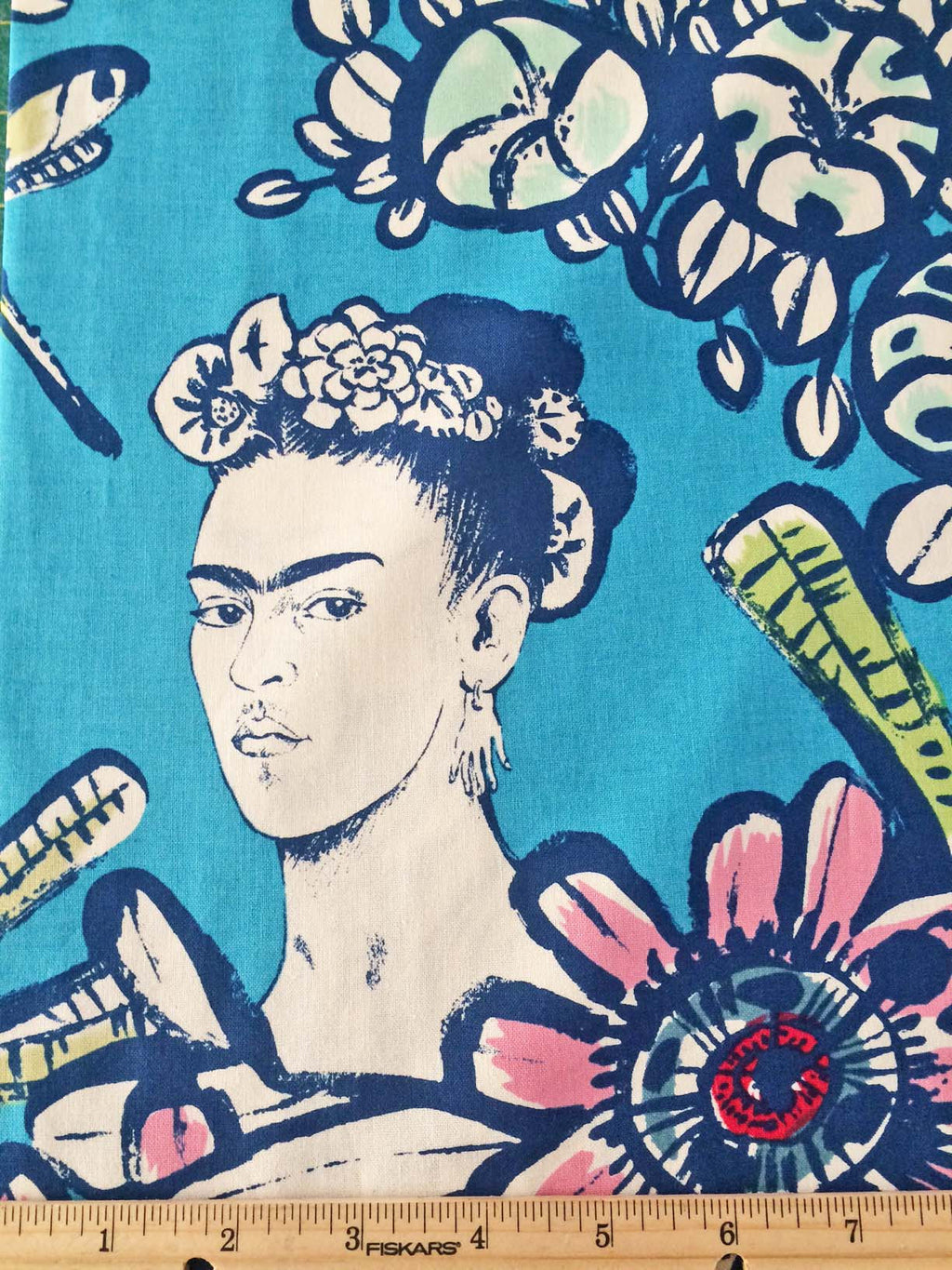 Frida faces and dragonflies on deep red cotton from Alexander Henry Fabrics - view 1