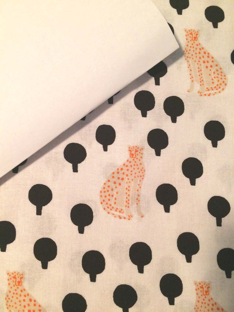 Light yellow cheetahs on pure white cotton with little black bushes from Andover Fabics. - view 5