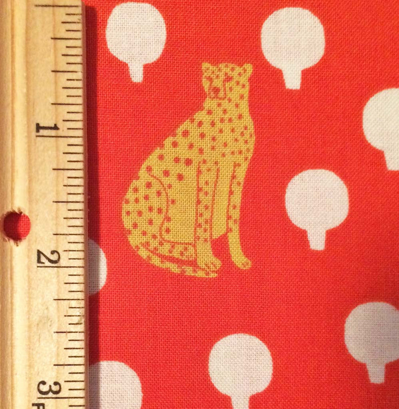 Cheetahs on rich bright red cotton with little circular bushes from Andover Fabrics. - view 3
