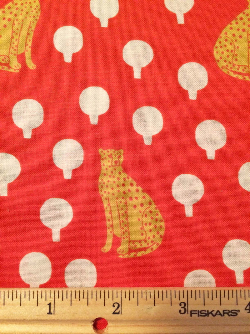 Cheetahs on rich bright red cotton with little circular bushes from Andover Fabrics. - view 4