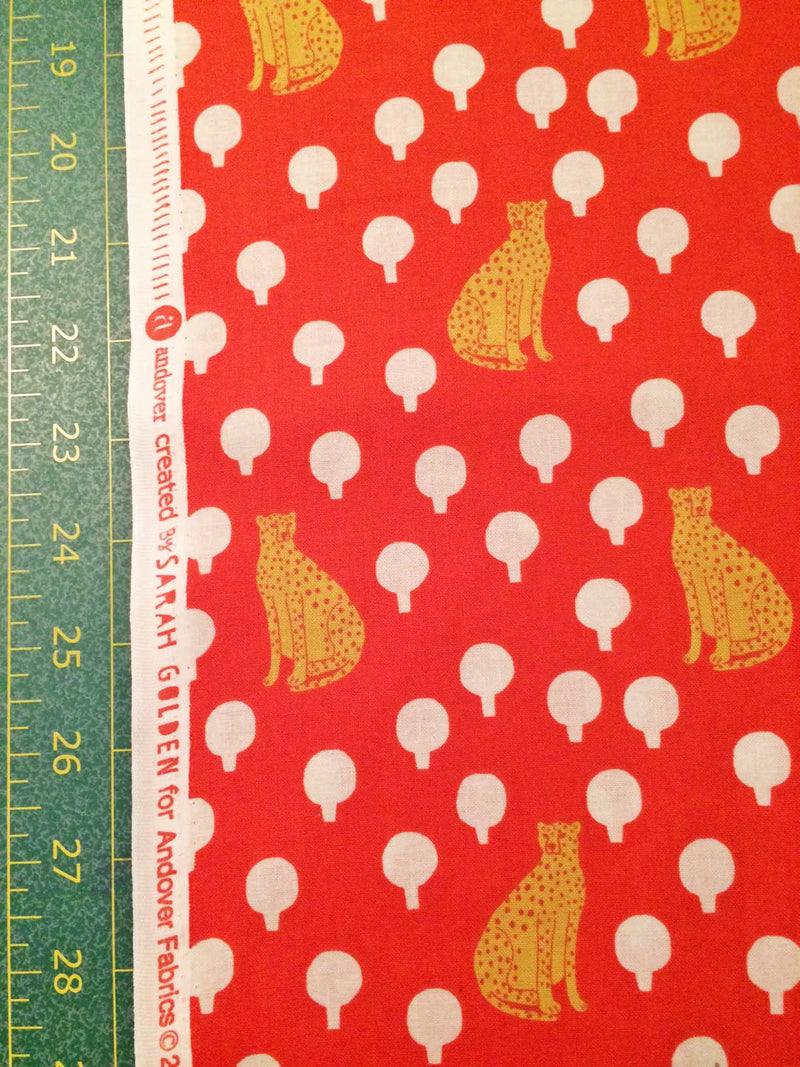Cheetahs on rich bright red cotton with little circular bushes from Andover Fabrics. - view 5