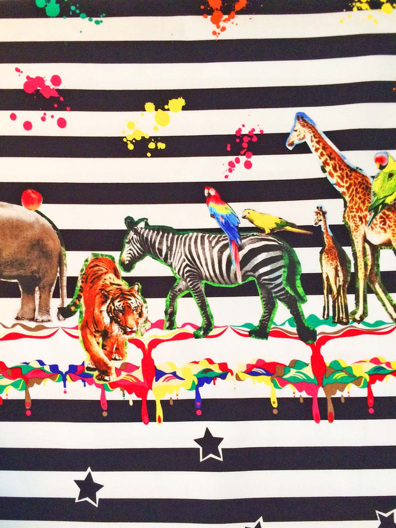 Black and white stripes on cotton with graphic wild animals and splashes of paint and stars - view 1
