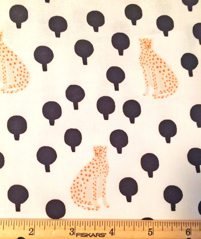 Light yellow cheetahs on pure white cotton with little black bushes from Andover Fabics. - view 3