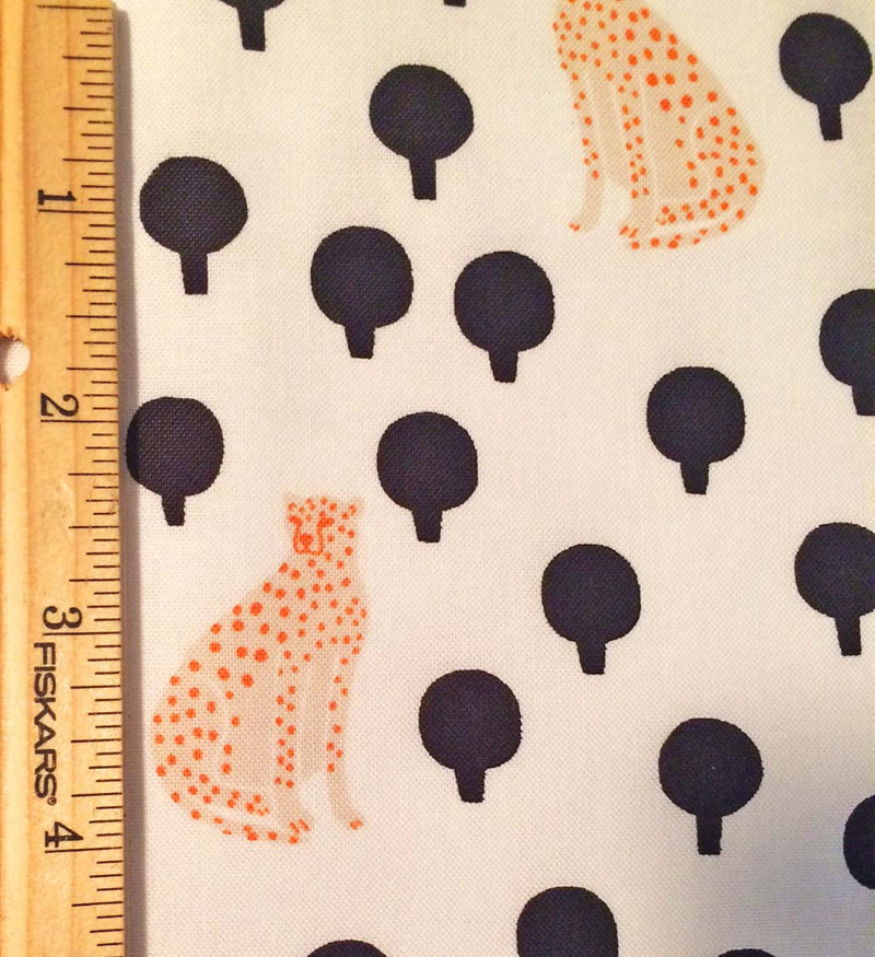 Light yellow cheetahs on pure white cotton with little black bushes from Andover Fabics. - view 4