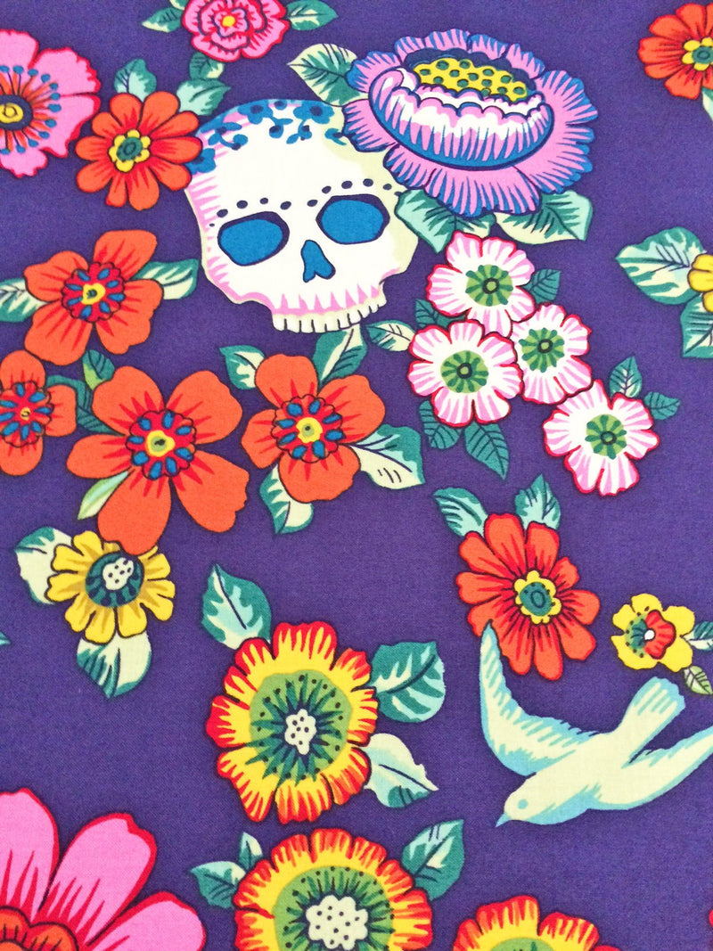 Frida figures and skeletons pose on floral fabric with large skulls and birds on cotton - view 8