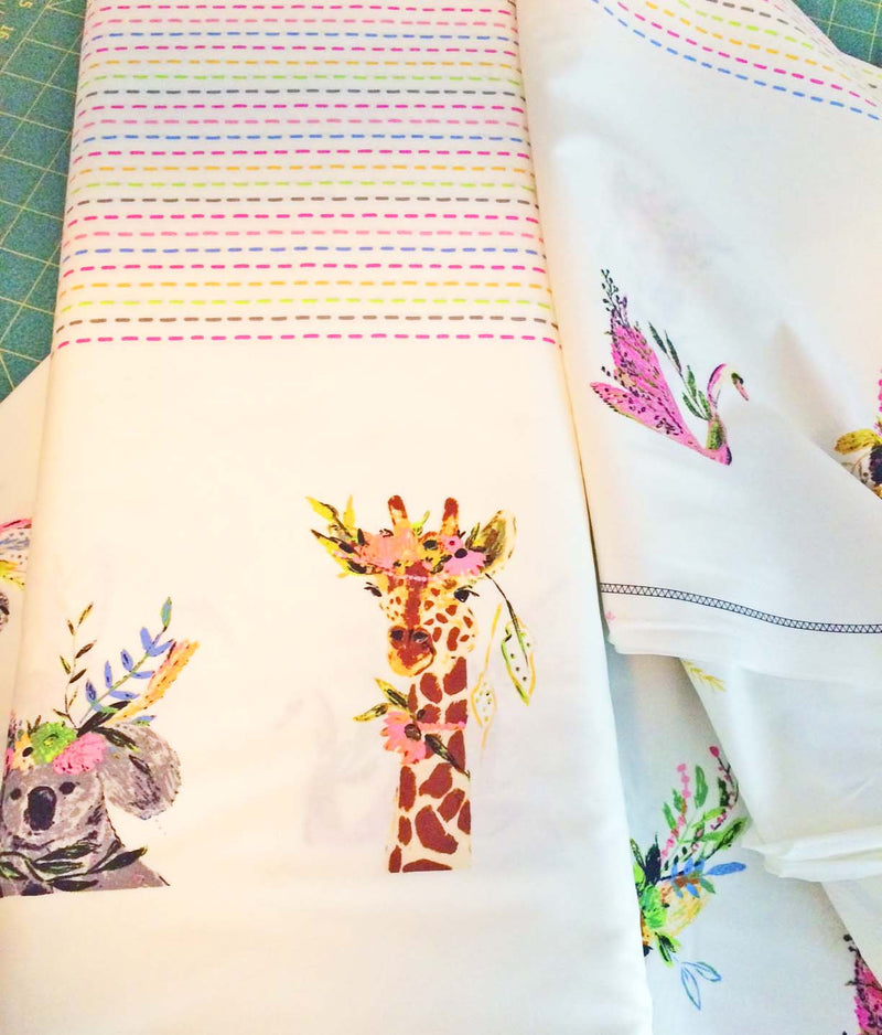 Animal faces along the edges of fabric with polka dots in the middle - view 4