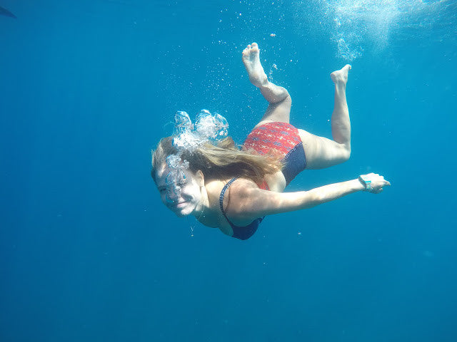 Blogger Devon DeMint swims in the ocean.