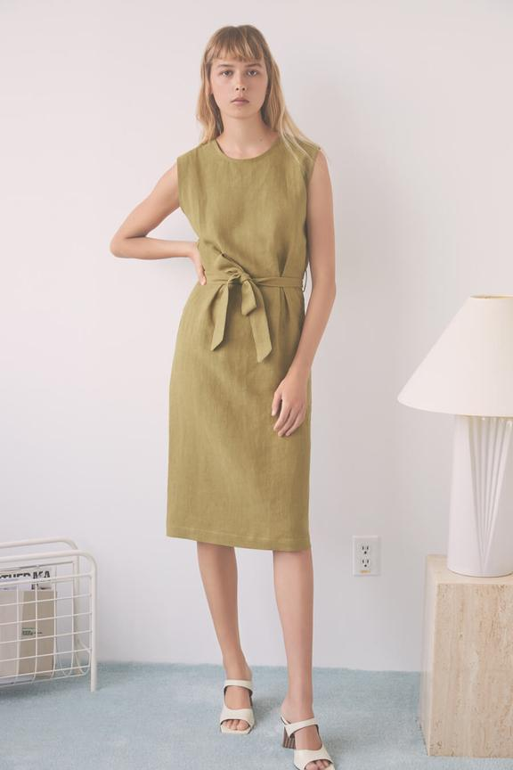 Olive Paloma dress with a front tie by Canadian slow fashion brand Eve Gravel falls just below the knee