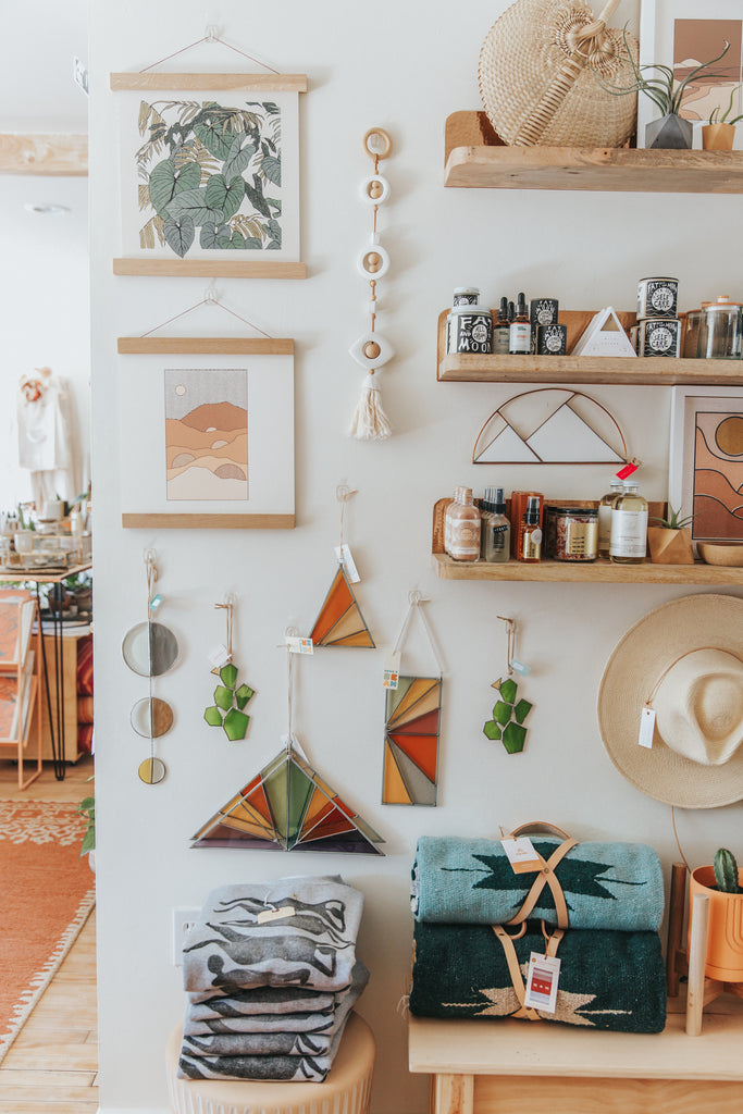 The interior of boutique Thread Spun in Encinitas, CA, showing many of their handmade and unique wall hangings and prints for your home