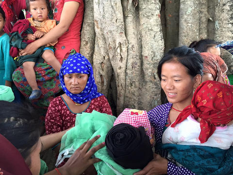 Nepalese women and families being aided by Circle of Health International, a nonprofit partner of social enterprise Thread Spun, which makes handmade surfboard bags.