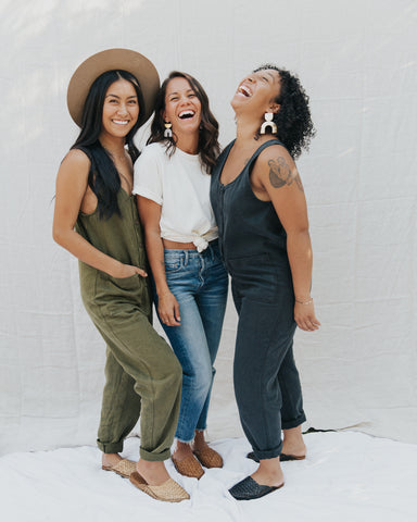 Three women wearing sustainable and ethical apparel by Thread Spun laugh together