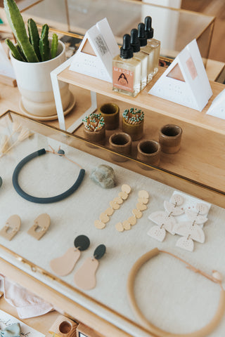 Handmade and unique jewelry and clean beauty products on display at boutique Thread Spun in Encinitas