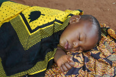 Tanzanian baby aided by Circle of Health International, a nonprofit partner of social enterprise Thread Spun, which makes handmade surfboard bags.