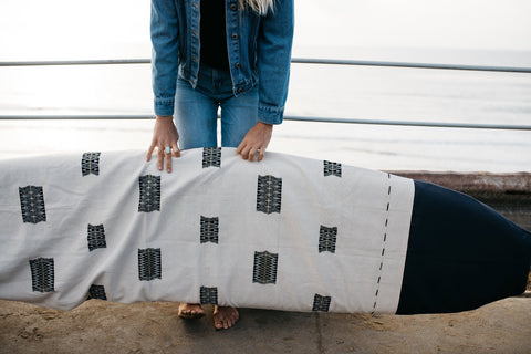 Handmade surfboard bag by Thread Spun featuring handwoven textiles from Burma.