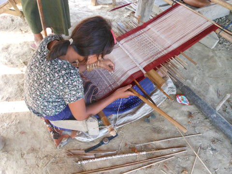A Chin weaver in Burma makes handwoven textiles like the ones used by Thread Spun to make surfboard bags and clutches.