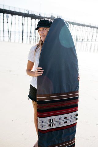 A handmade surfboard bag by Thread Spun uses artisan textiles from Burma.