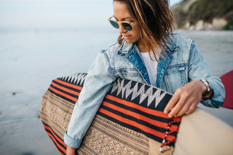 Mele Saile for Thread Spun with a handmade surfboard bag featuring handwoven textiles from Burma.