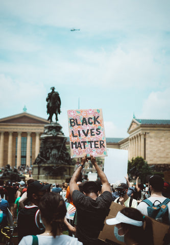 Black Lives Matter protestors in front of a monument