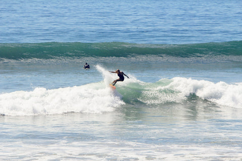 Devon DeMint surfs a wave in Encinitas, California.