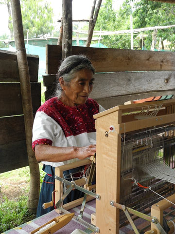 Maya artisan and member of the El Camino de los Altos cooperative creating textiles sold by Thread Spun
