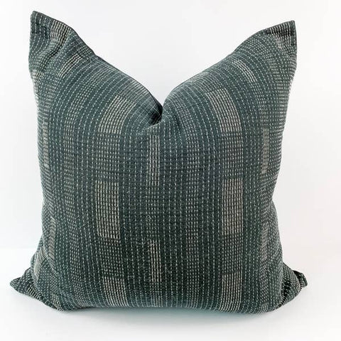 Hand stitched and fair trade ember pillow in deep green with white accents made in Thailand