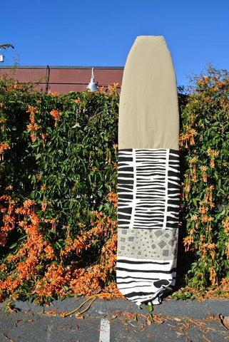 A handmade surfboard bag with Bogolan mudcloth and handwoven textiles at the Thread Spun storefront in Encinitas, CA