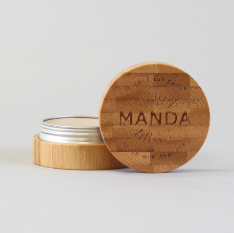 Organic and all natural sun paste or sunscreen by Manda is reef safe and kid safe