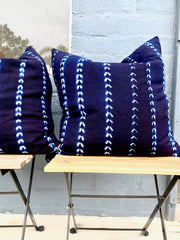 Handmade and fair trade throw pillows in indigo mudcloth made by resettled refugees for Thread Spun