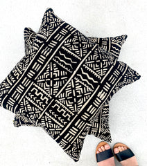 Handmade and fair trade throw pillows in black bogolan mudcloth made by resettled refugees for Thread Spun