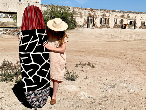 Heidi Ledger of Thread Spun displays her handmade surfboard bag while wearing ethically and sustainably produced clothing in Mexico