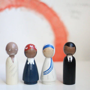 "Handmade, classic wooden peg dolls hand-painted with non-toxic paints. The Peace Makers set includes artistic representations of Gandhi, Harriet Tubman, Mother Teresa, and Martin Luther King, Jr.  Includes four 3.5"" dolls."