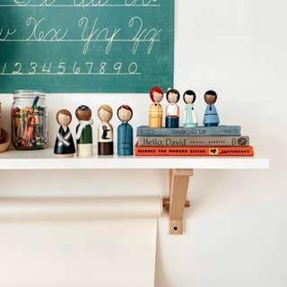 Handmade and fair trade wooden peg dolls. The Trailblazers set includes artistic representations of Jane Goodall, Suffragette, Rosie the Riveter and Bessie Coleman.