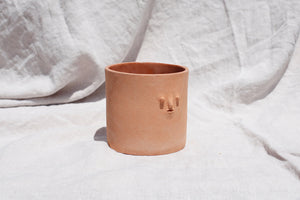 terracotta mini face planter handmade by rami kim in los angeles