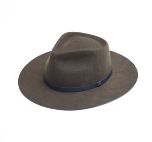 This handmade fedora hat is sustainably made with salvaged and recycled materials. This felt fedora hat has a stiff fit that is sure to break in like a beauty. It sports a wide raw edge stiff brim, tear drop crown, and leather trim. 100% Merino Wool.